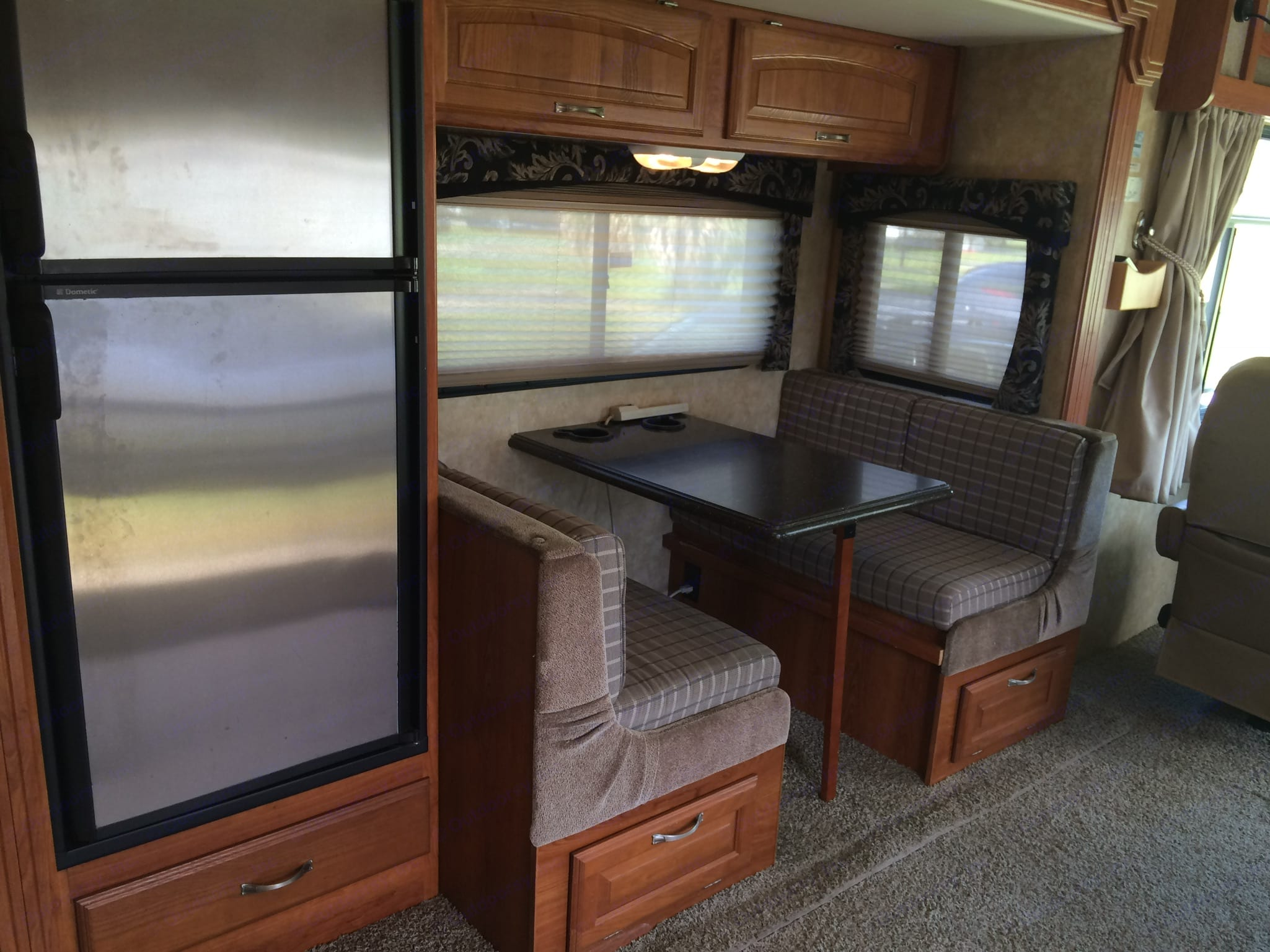 3-way refrigerator/freezer; dinette with Corian tabletop folds down to bed.. Coachmen Mirada 2009