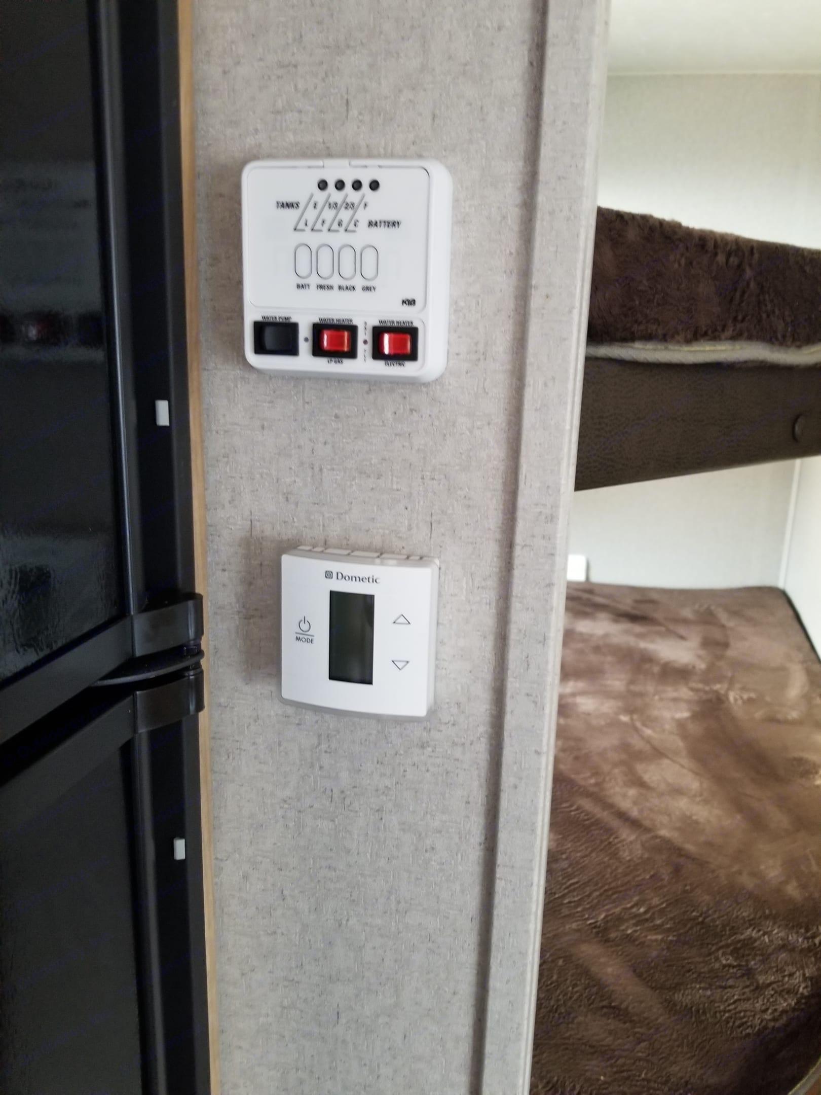 15,000 BTU A/C with wall controls. Coachmen Freedom Express 2018