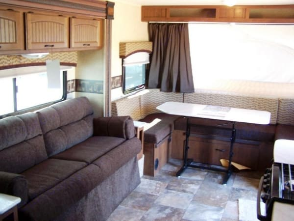 Interior showing U-shaped dinette and couch. Jayco Jay Feather 2014