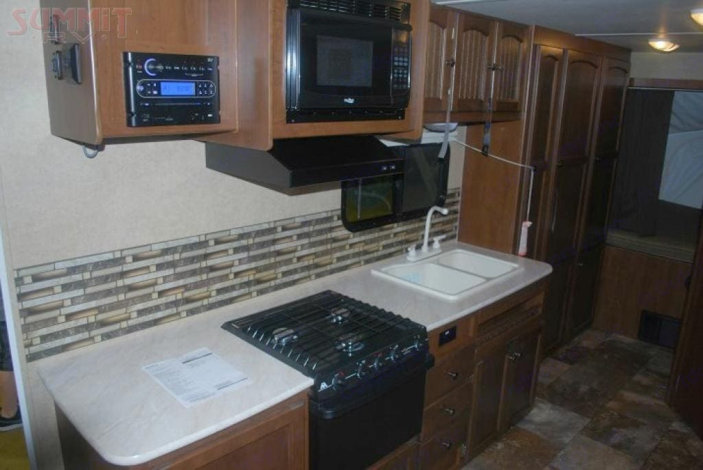 """Kitchen. This pic does not show 24"""" Flatscreen TV. Jayco Jay Feather 2014"""