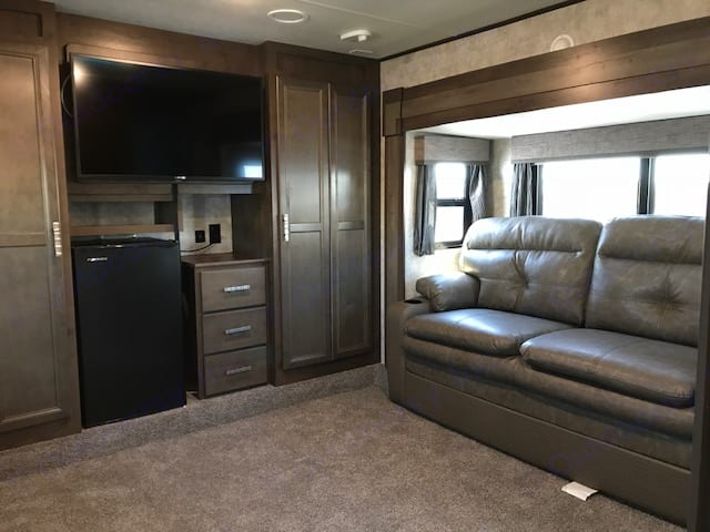 TV room by day, 2 queen beds at night. Open Range Roamer 2018