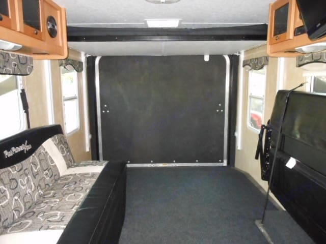 View looking back, additional bed drops down with just the touch of the switch. . Cruiser Rv Corp Fun Finder Xtra 2010