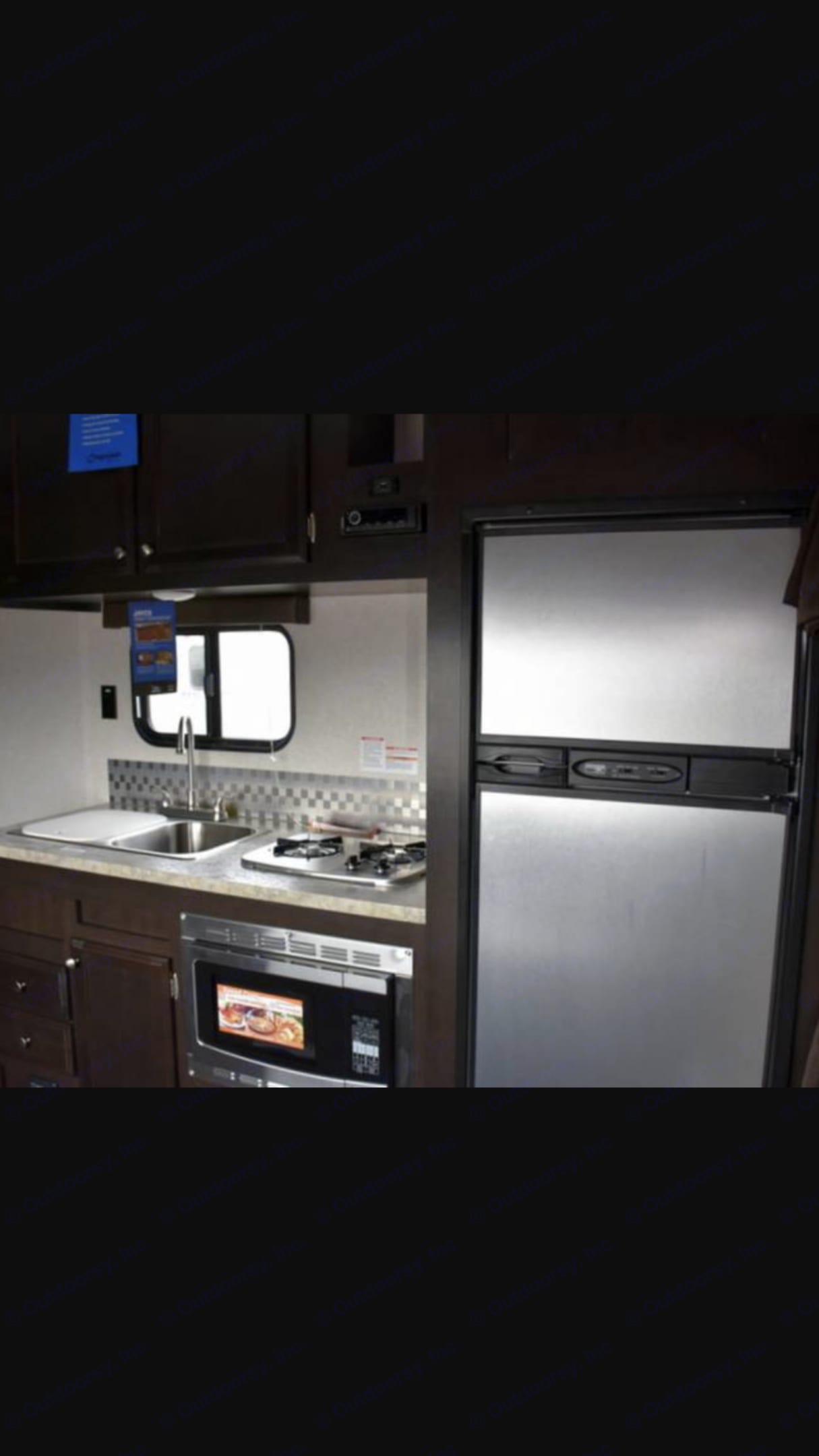 Double sink with cutting board. Gas/electric fridge. Jayco Octane 2017