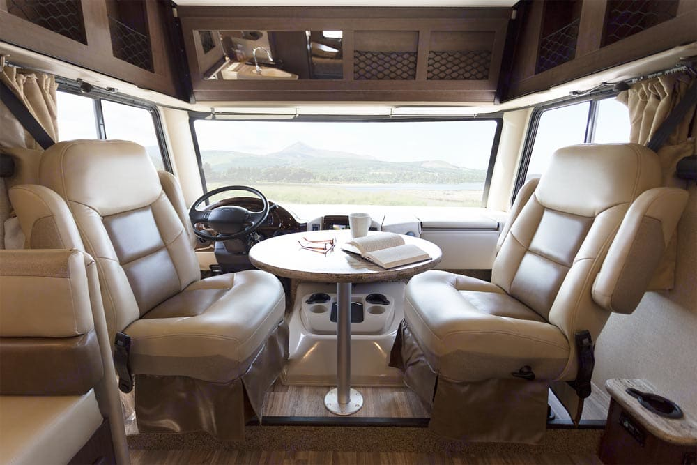 Indoor driver and passenger seats with removable table.. Thor Motor Coach A.C.E 2017