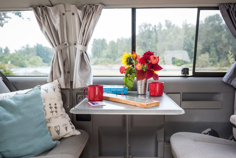 A table inside the van swings up for dining or playing cards.. Volkswagen Eurovan Weekender 2002