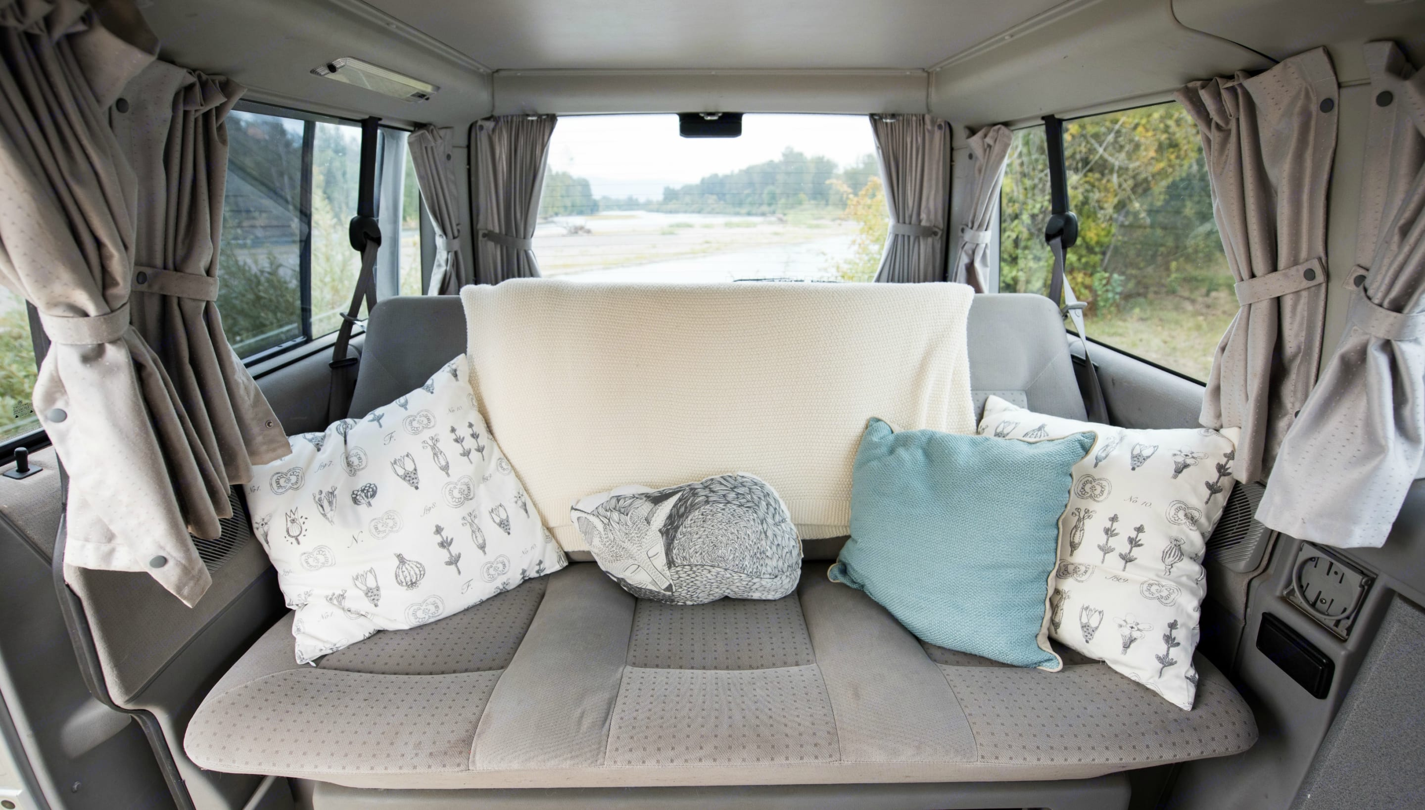The Eurovan Weekender seats three in the back seat, and also includes a rear facing jump seat behind the driver for a total capacity of six passengers.. Volkswagen Eurovan Weekender 2002