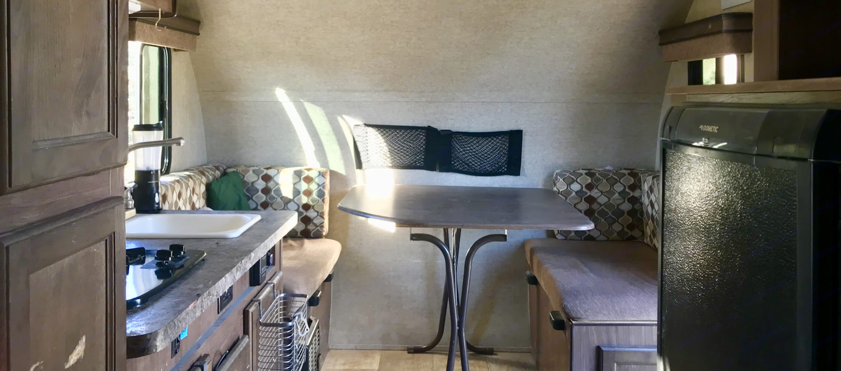 Table that folds down to a single bed.. Forest River Palomini 2016