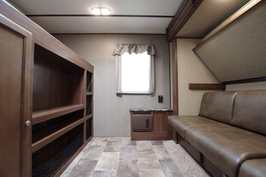 Bunk room in the rear with couch that pulls out into queen bed. Keystone Sprinter Campfire 2016