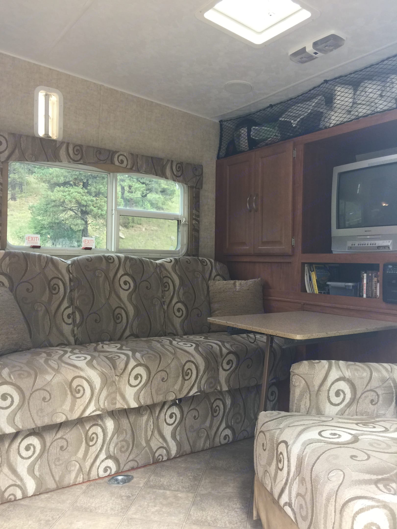 Additional dining table can be put away or extended to seat up to 6. . Sandpiper Toy Hauler 2008