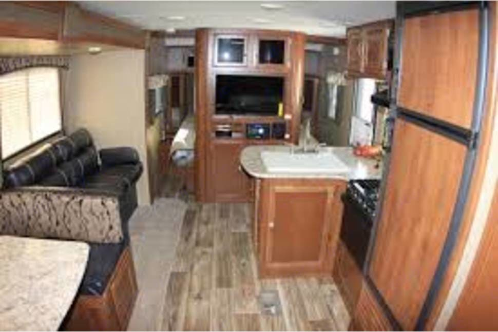 Mid interior forward.  Kitchen on Rt, Living and Dining on Lt, Bedroom forward.. Keystone Passport Ultra-Lite 2015