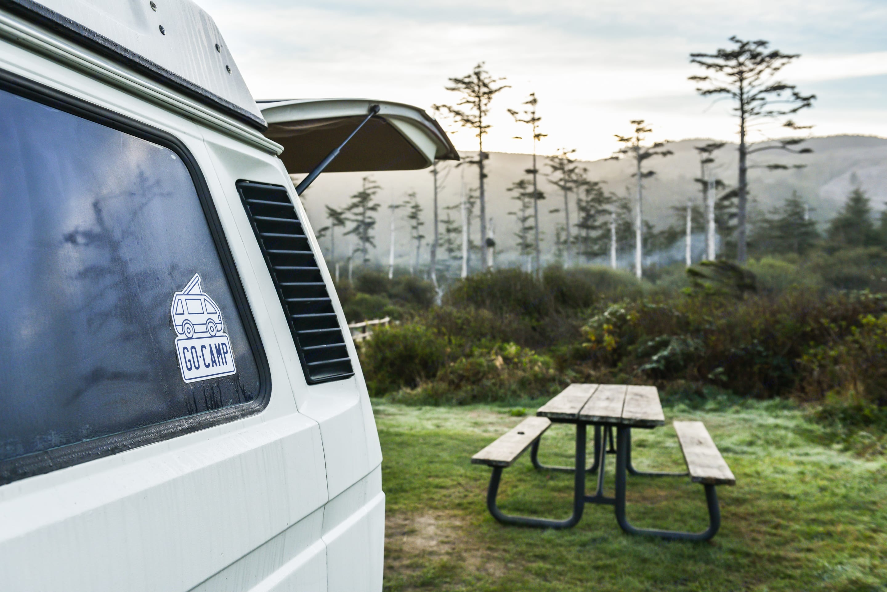 Dine outside at the campground, or inside the van by raising the interior table.. Volkswagen Vanagon Weekender 1986