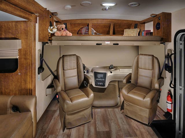 Cockpit w/ privacy shades and seats turned toward living area. Includes overhead dropdown bed.. Forest River FR3 2018