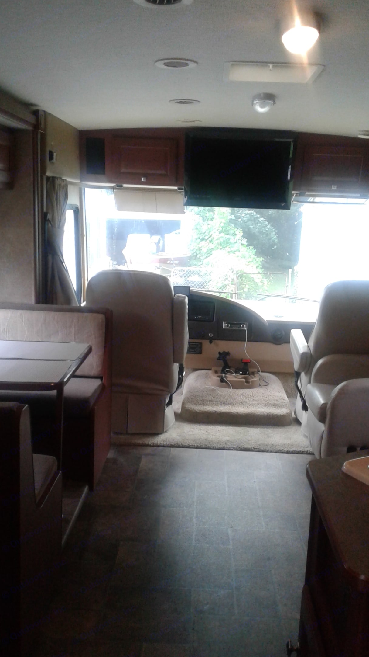 Captain chairs that turn all the way around making a great area for socialization. Booth table that lets down to a smaller bed. Winnebago Vista 2013