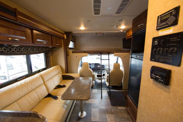Seating and dining area convert into full beds. Thor Motor Coach Outlaw 29H 2016