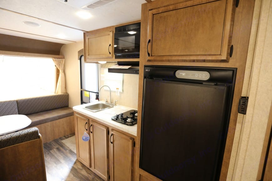 Kitchen includes refrigerator, small freezer, 2 gas burner, sink, and microwave. . Starcraft Launch 2017