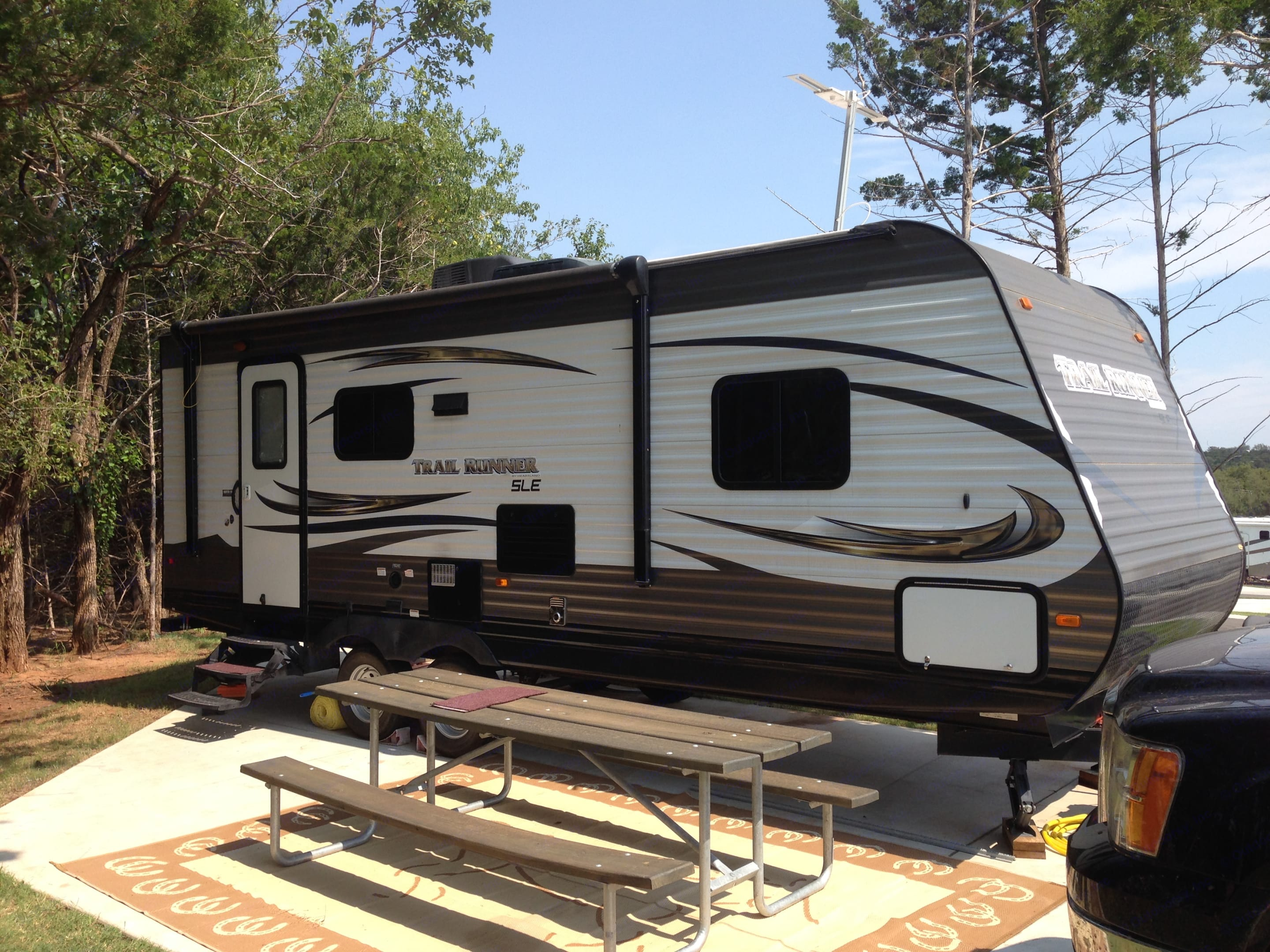 Nice weekend getaway camper!!! This camper is the right size to pull anywhere that you want to spend some enjoyable time. . Heartland Trail Runner 2015