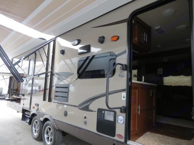 Dual power awnings to give you lots of shade!. Forest River Rockwood Signature Ultra 2013