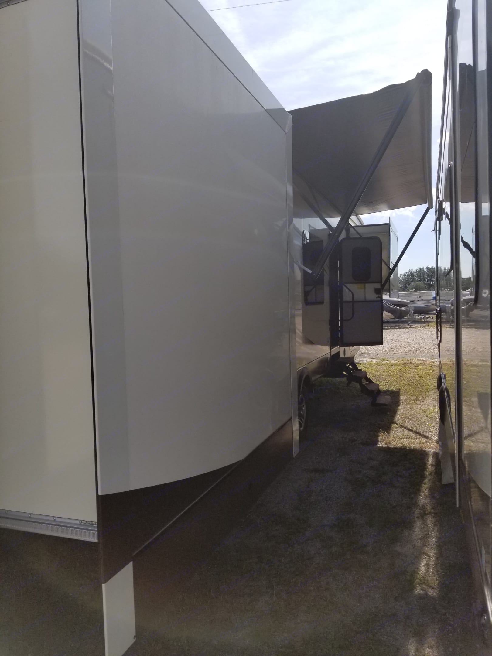 Looking at the Right side of the RV from the rear with the slides and awning extended.. Jayco Eagle Premier 2015