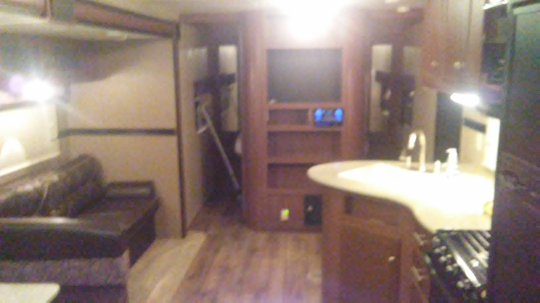 Master bedroom behind entertainment center. queen size mattress. Dutchmen Aspen Trail 2015