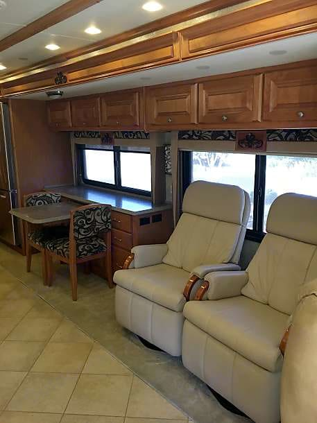 The two recliners are able to move so you can face them towards the large front TV.. Tiffin Motorhomes Allegro Phaeton 2010