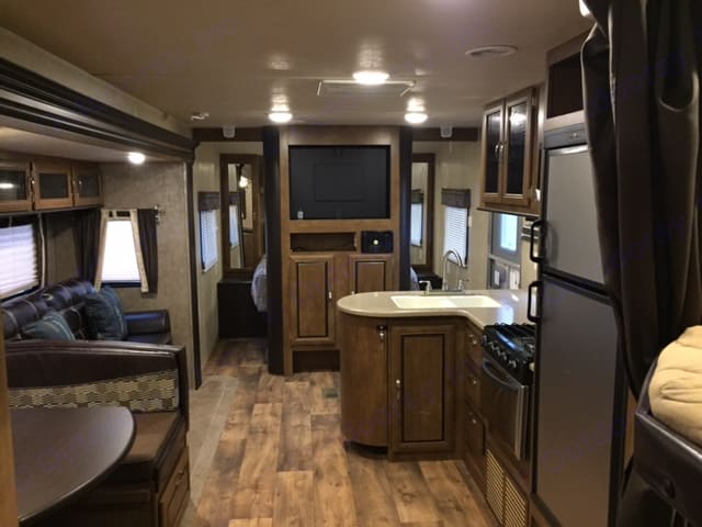 Entertainment Center with TV, DVD and Stereo system with inside and outside speakers. Forest River Wildwood 2017