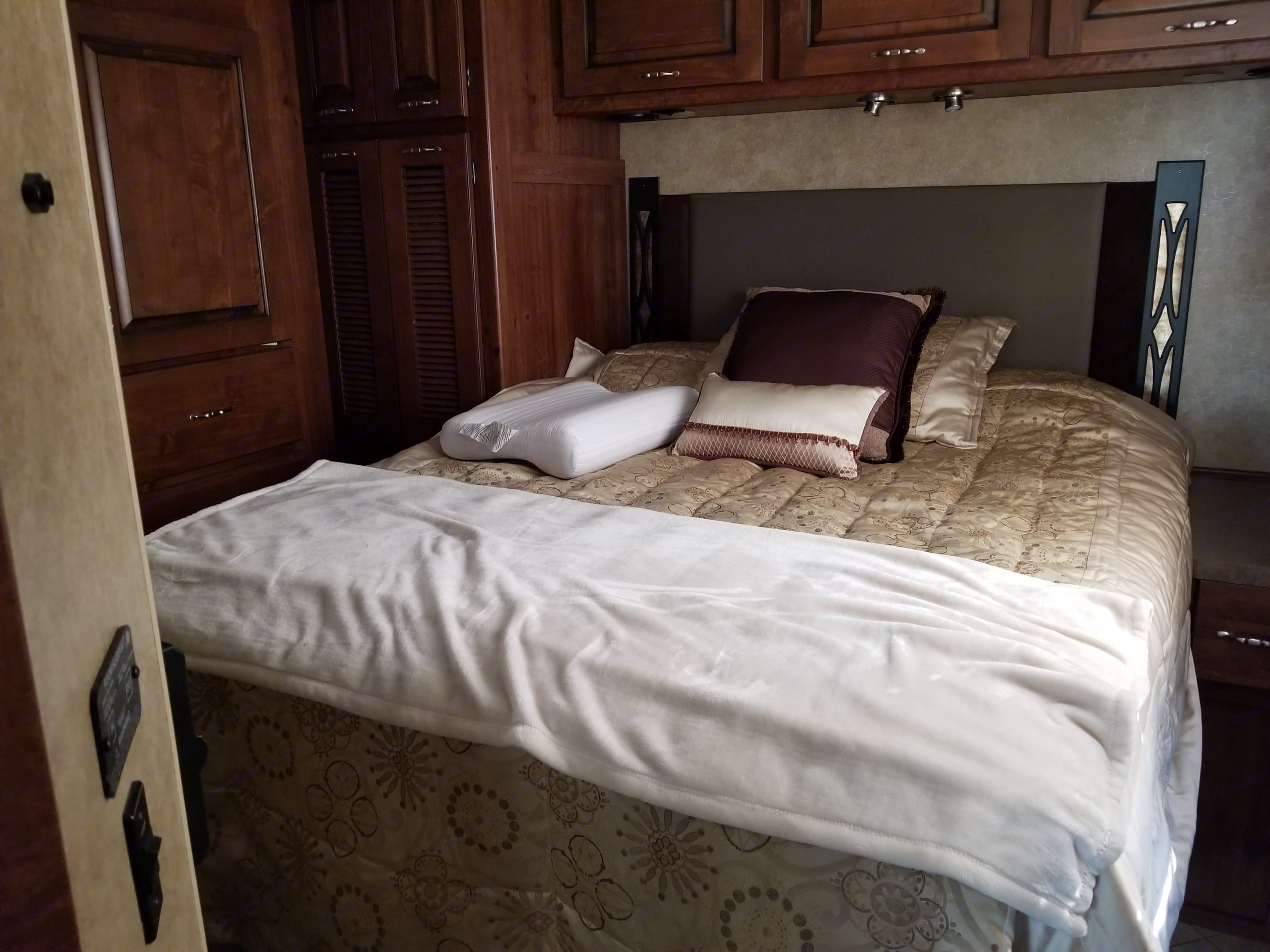 Bedroom with comfy queen size bed and mattress toper.. Fleetwood Excursion 2013