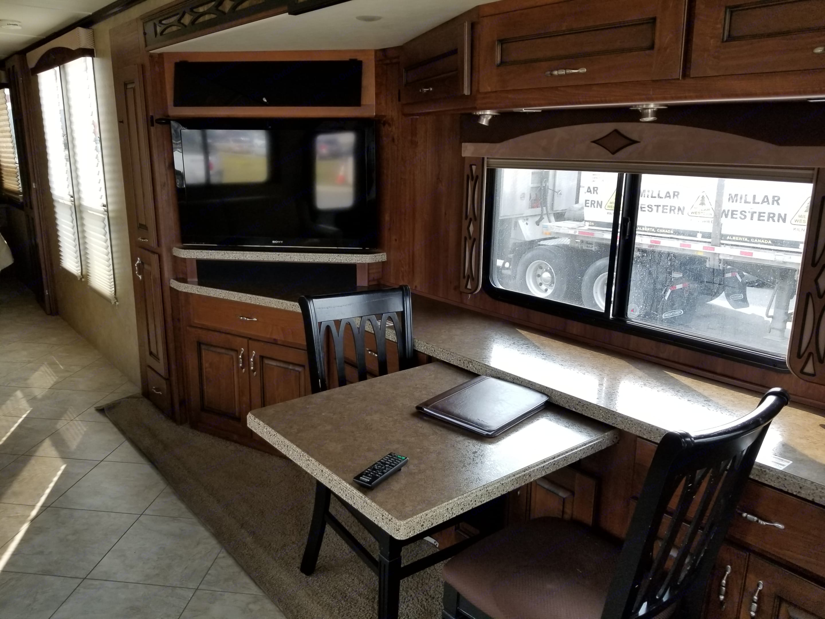 Dinette pulls out to accommodate 4. Fleetwood Excursion 2013
