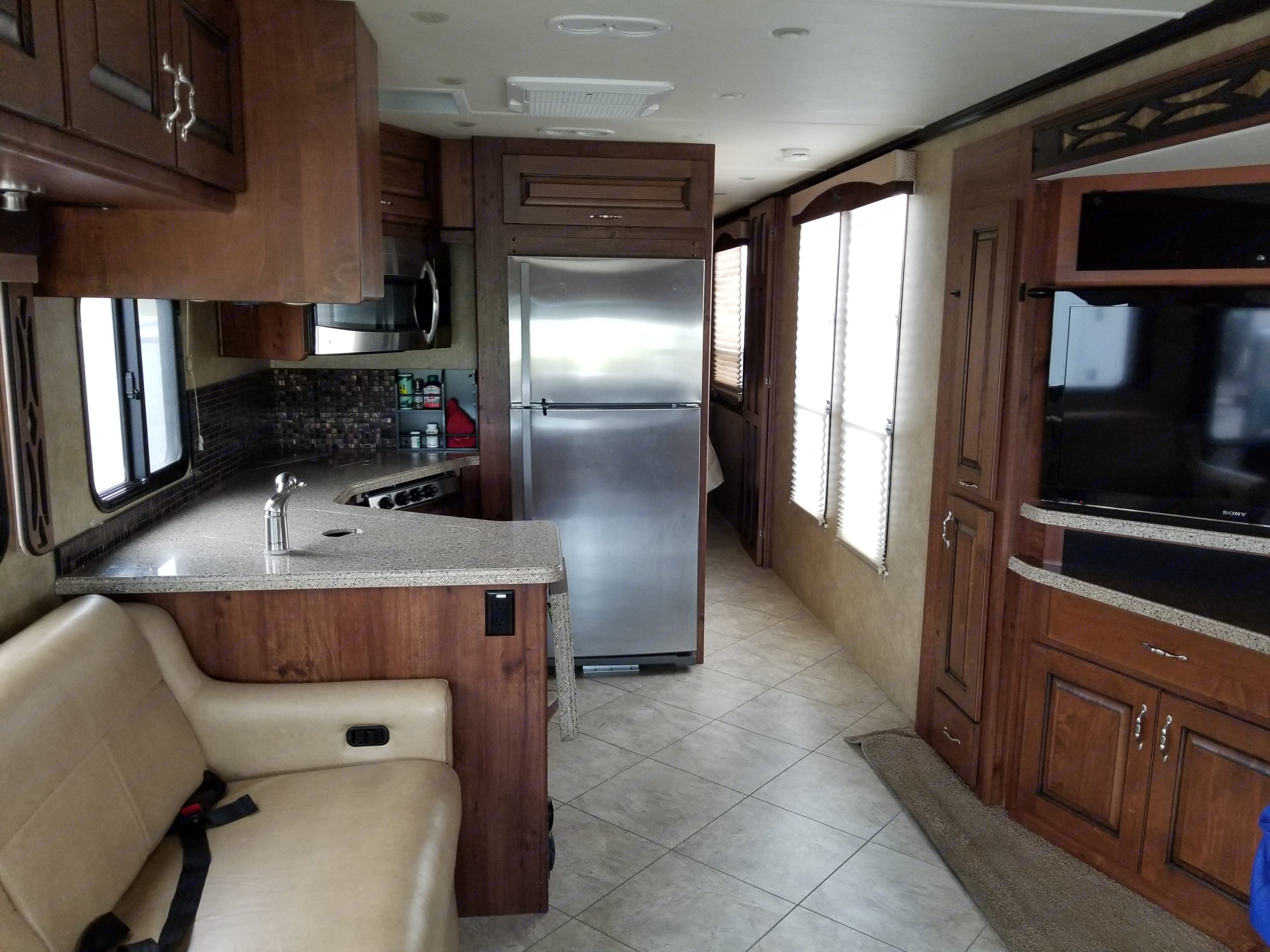 Spacious kitchen with full size residential refrigerator.. Fleetwood Excursion 2013