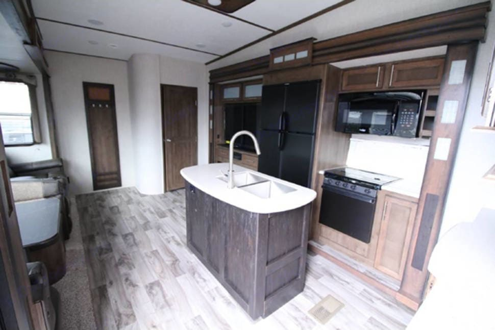 Main living area - Double door fridge and kitchen island and sink. Keystone Cougar 2018