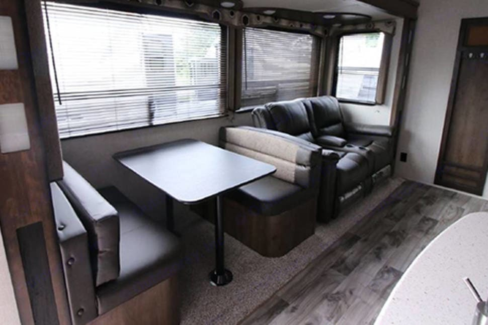 Main living area - Full size dinette and reclining theater seats. Keystone Cougar 2018