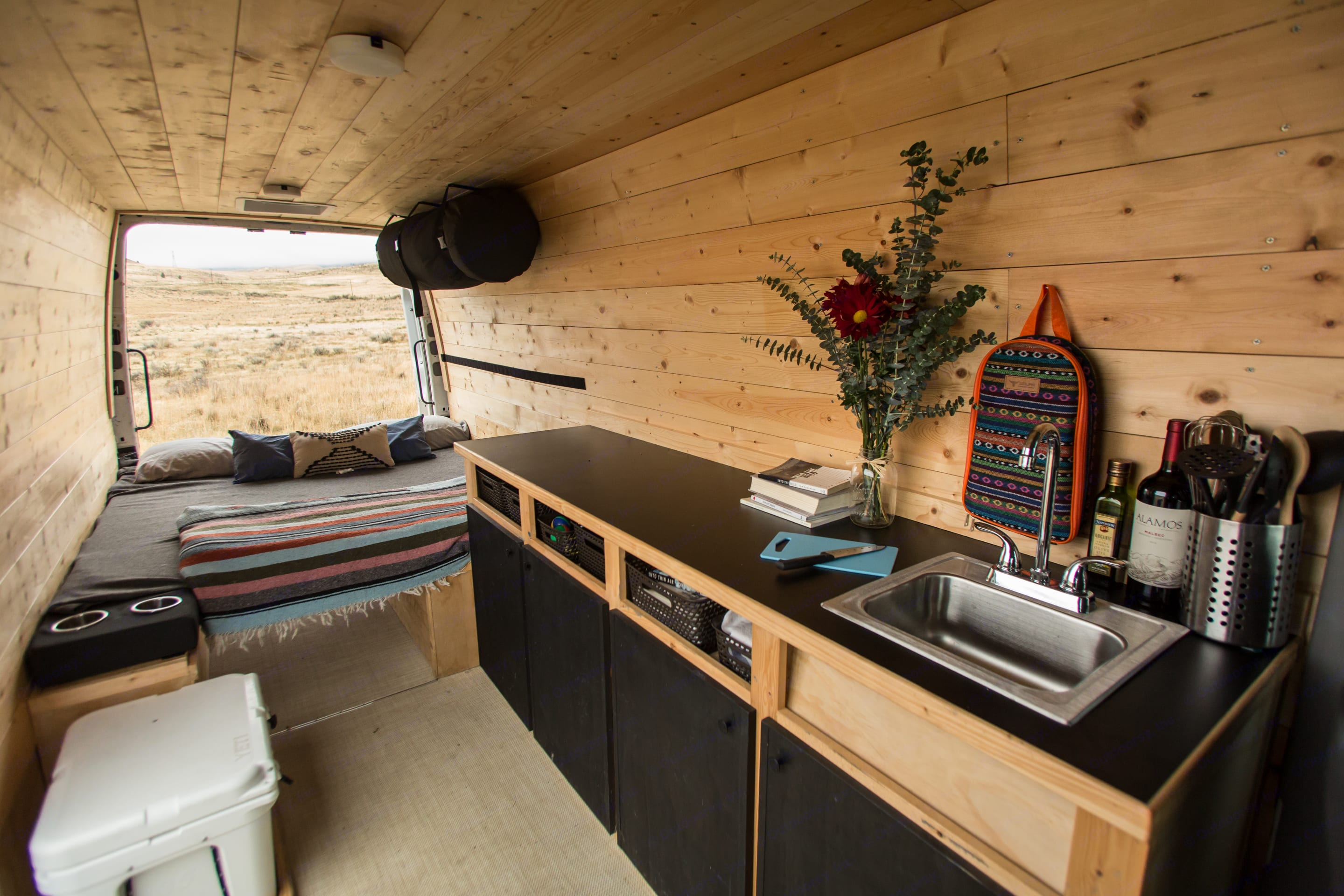 Pine wood walls surround you in this cozy home on wheels.. Freightliner Sprinter 2007