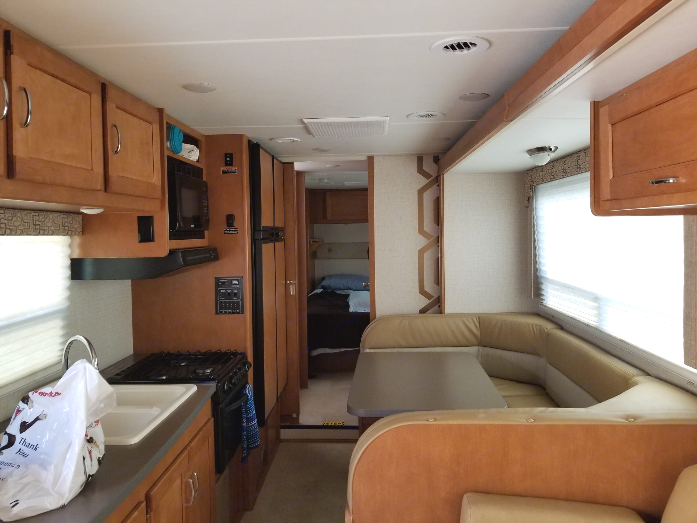 Kitchen, couch and dinette. Itasca Spirit 2016