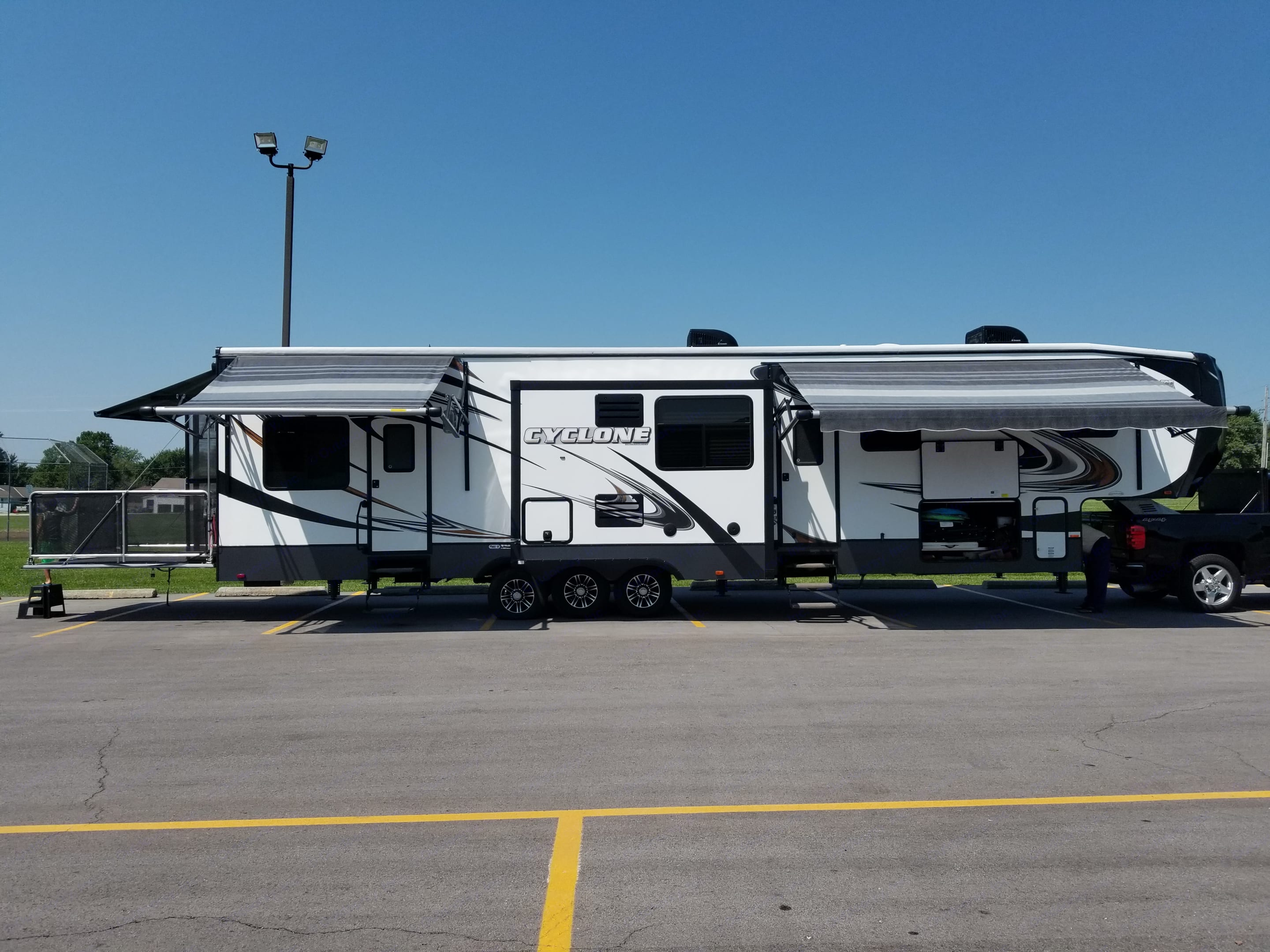 Fun, spacious toy hauler with an outside deck!  Room for your toys also or a play room for the kiddos!. Heartland Cyclone 2014