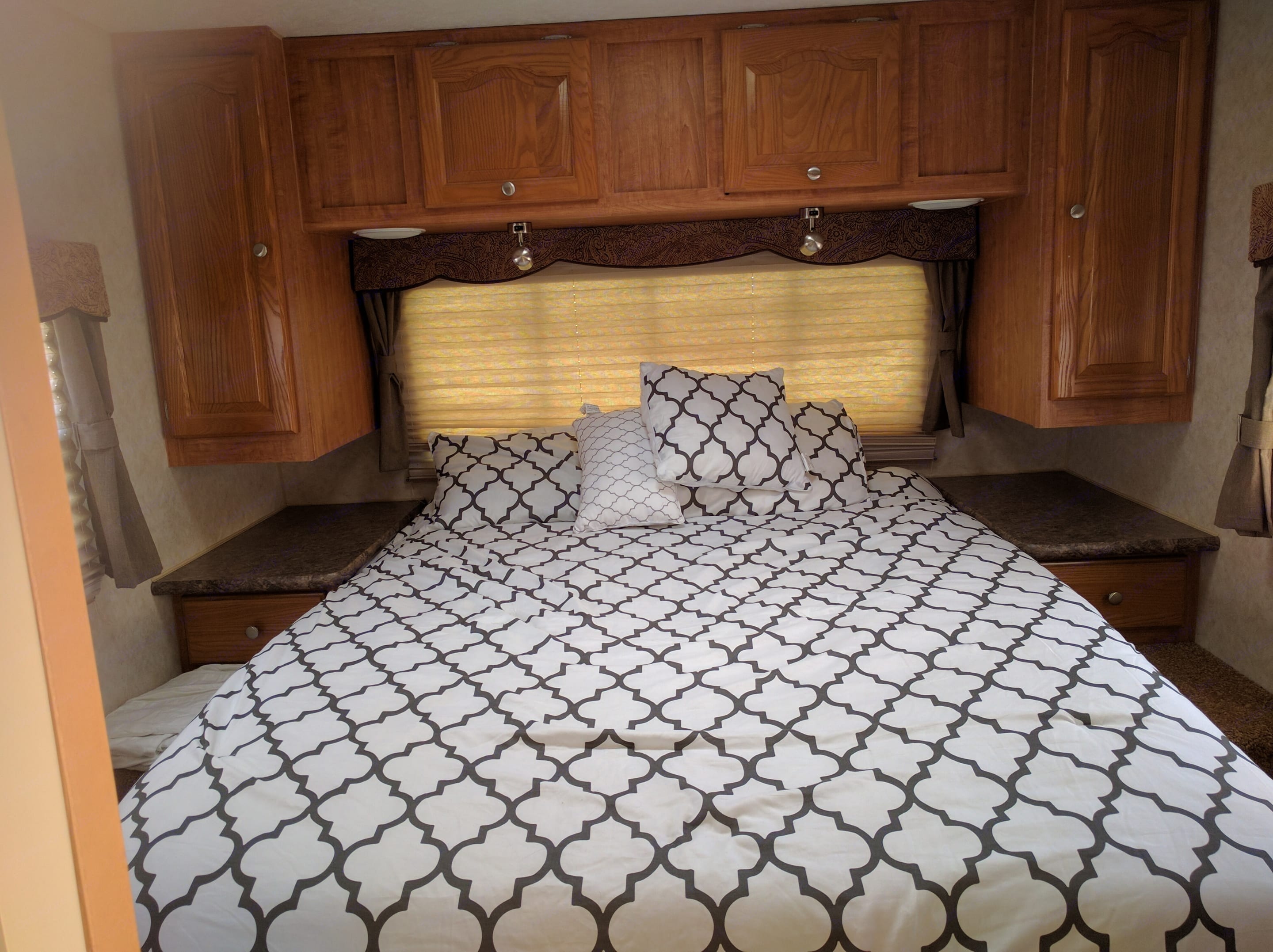 Sleep in super comfort in this deep pocket queen size bed!!  Plenty of Storage and all with Privacy. Forest River Rockwood Signature Ultra 2010