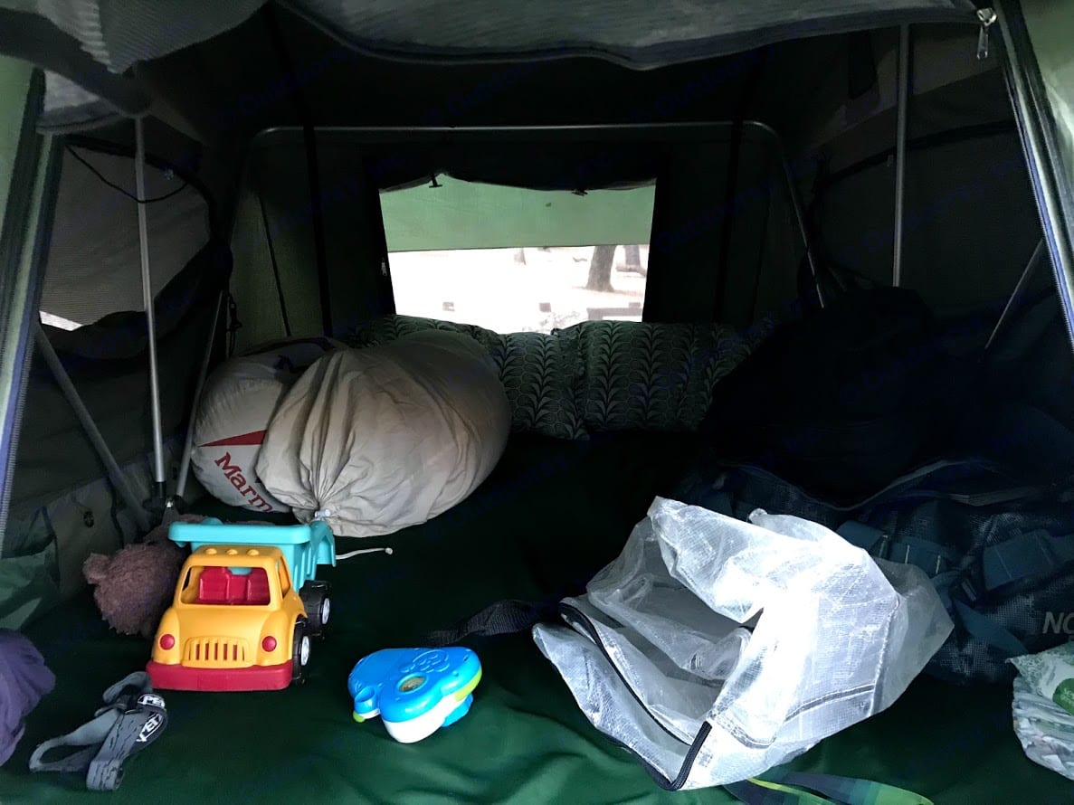 """The tent includes a 94"""" x 55"""" x 2"""" thick mattress, small storage pockets sewn to the walls and places to hang gear.. Mombasa Outdoors 9008 Expedition 2009"""