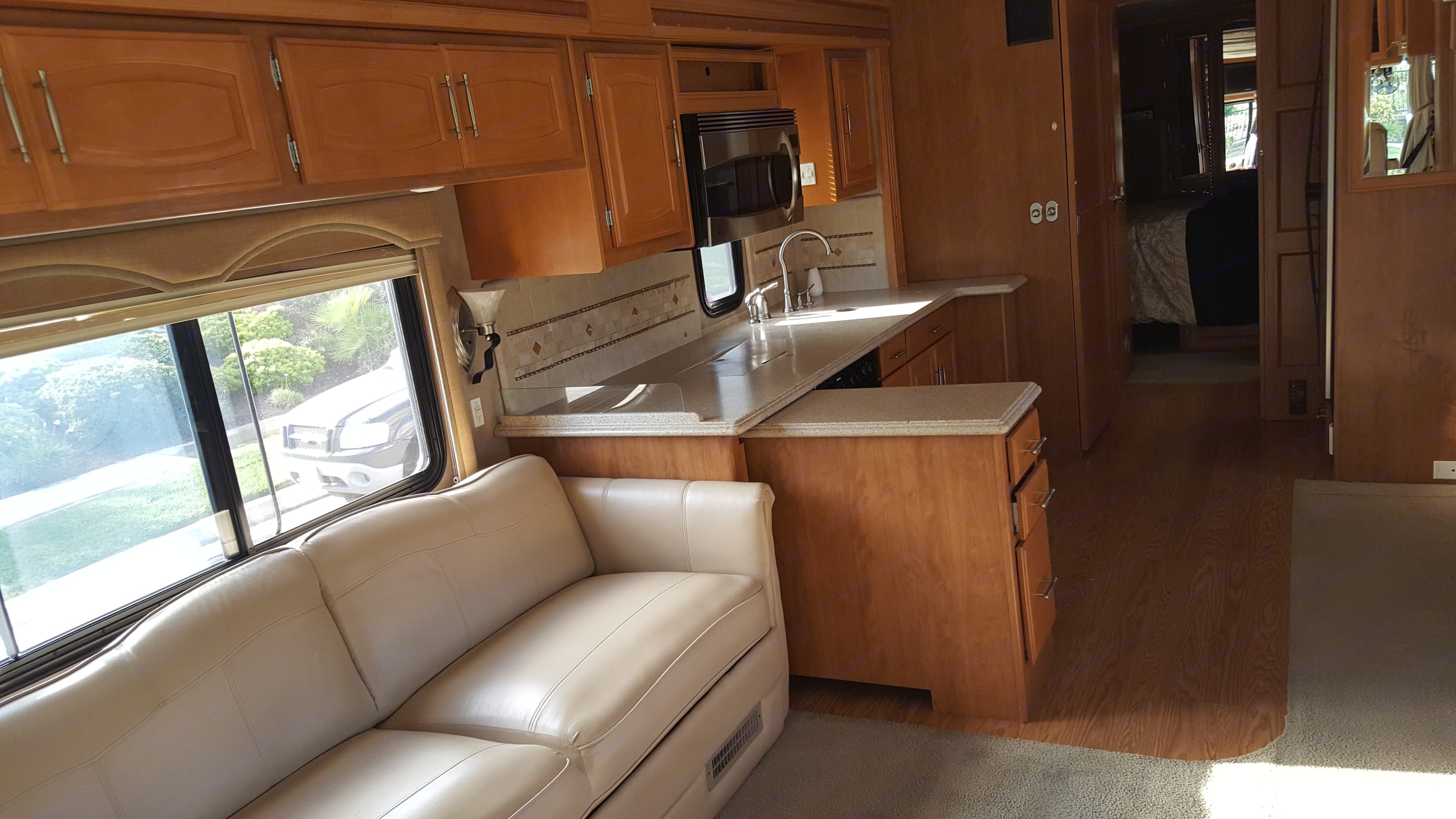Plenty of counter space and a return that shows up when you do the slide out! Large leather couch turns into a flat bed that can be used even while driving if needed!. Fleetwood Providence 2007