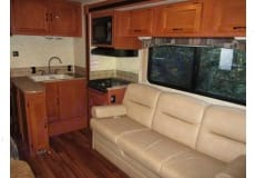 Comfortable kitchen, one slide out, couch converts to bed. Coachmen Freelander 2013