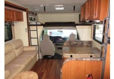 Done the converts to bed, double bed above can and ALL seats have seat belts . Coachmen Freelander 2013