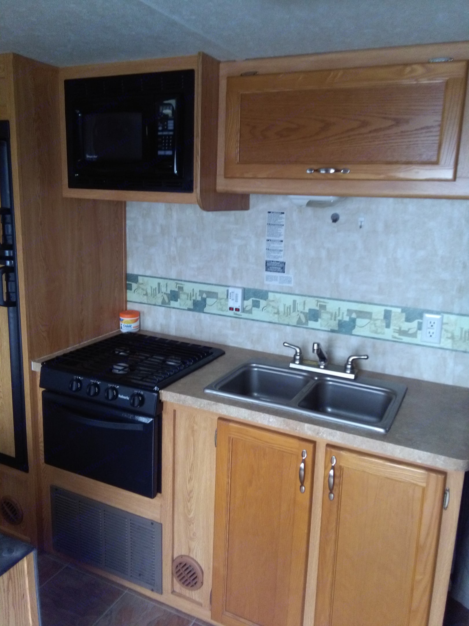 3 burners,oven, micro wave above , double sink. Forest River Cherokee Grey Wolf 2009