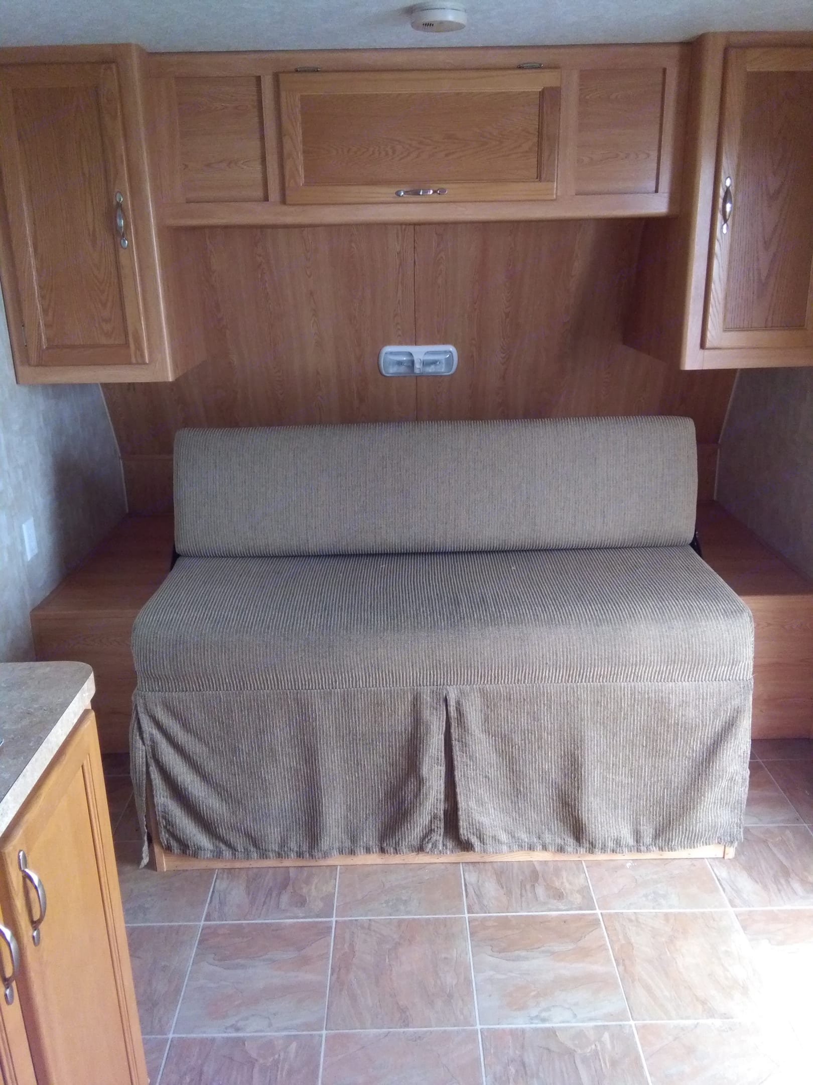 bed converts easily to couch. Forest River Cherokee Grey Wolf 2009