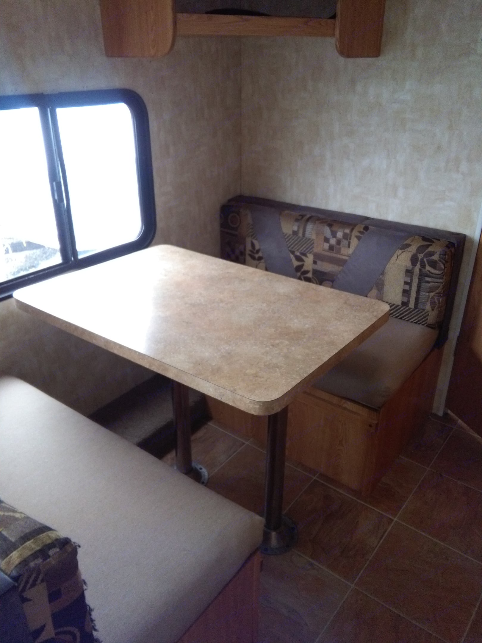 table drops to 3/4 bed. Forest River Cherokee Grey Wolf 2009
