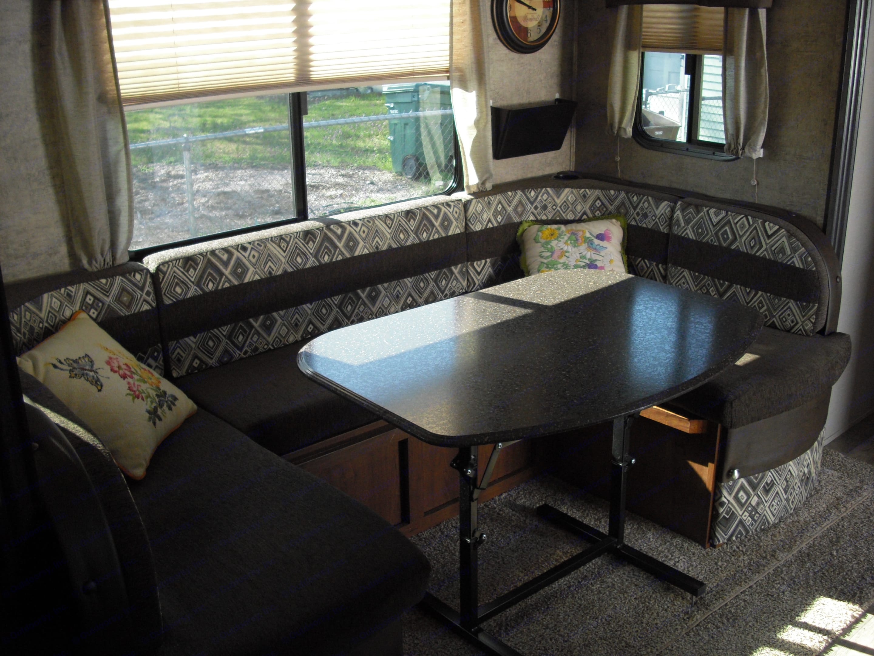 Comfortable dinette that makes into a large bed.. Coachmen Freedom Express 2016