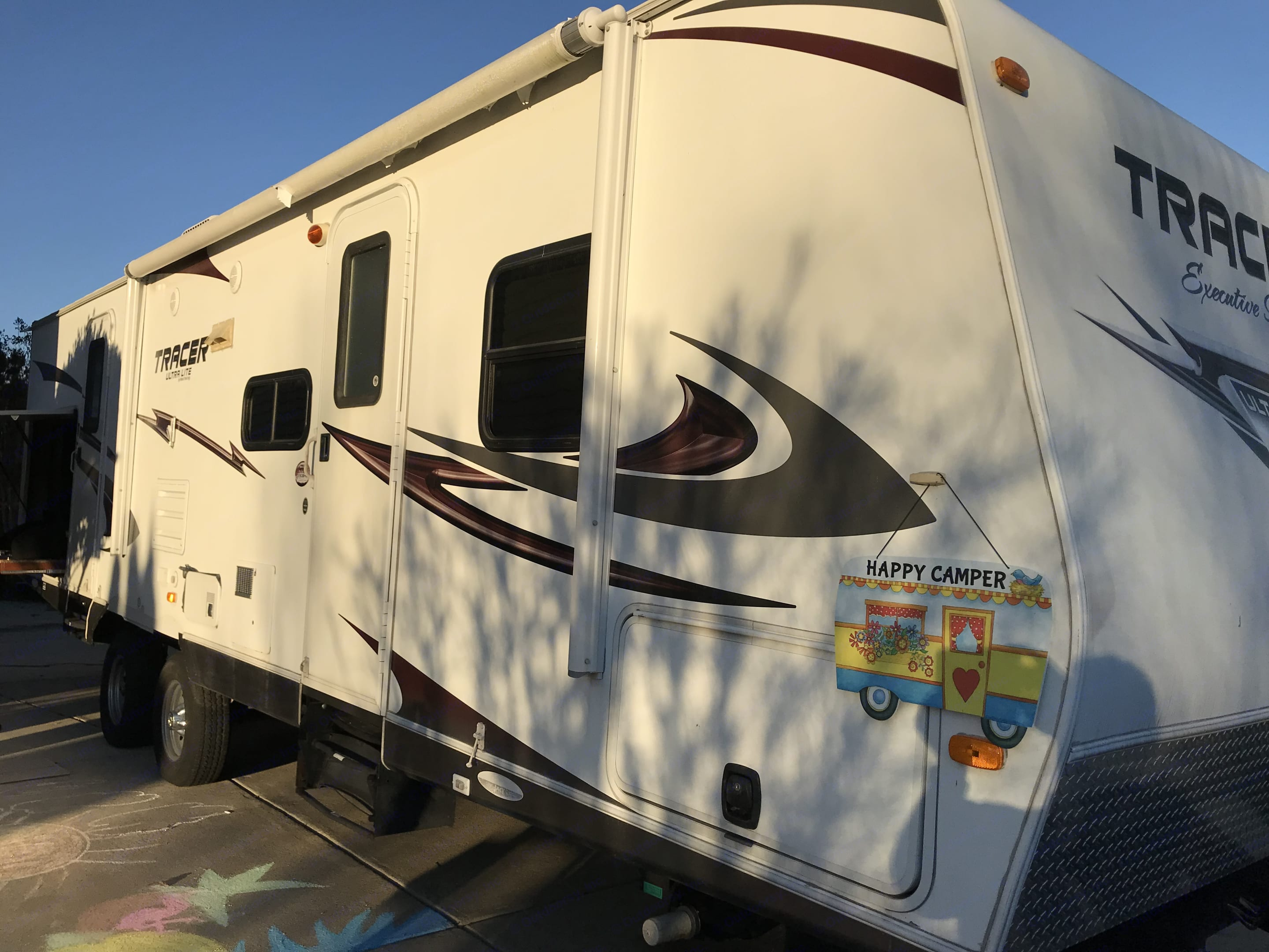 Front storage, outside kitchen with refrigerator and grill, electric retractable awning.. Keystone 3150BHD 2011
