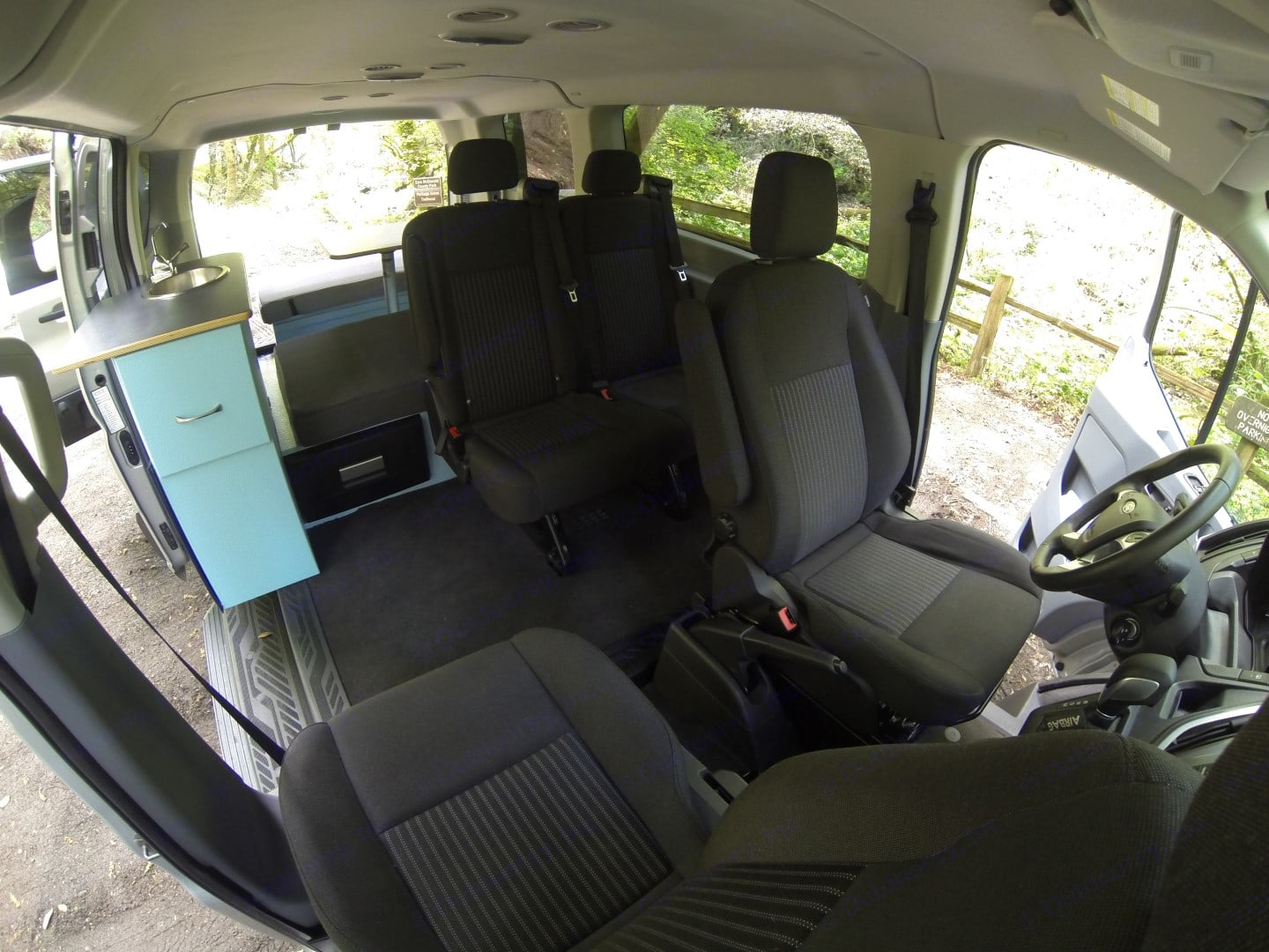 The front passenger side seat swivels around so you can relax and stretch out your legs. We can remove the two seats in the back if you only have 1-2 travelers and want more space. All our Trekker Vans include an 8-gallon refrigerator and a 7-gallon sink ready for your adventure. . Ford Van 2016