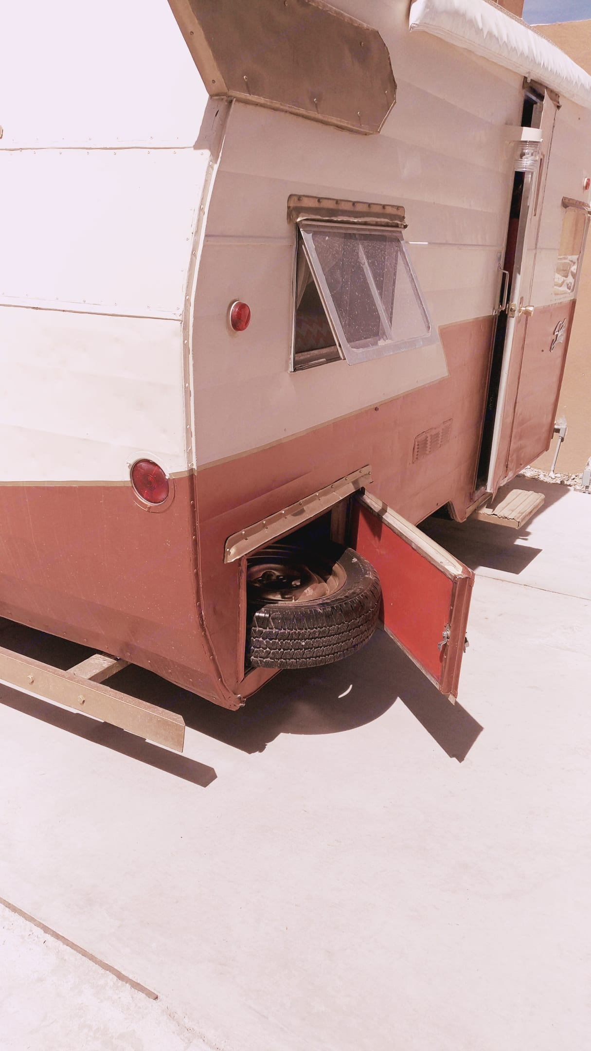 Rear, right under bed storage compartment outside access. Shasta Airflyte 1959