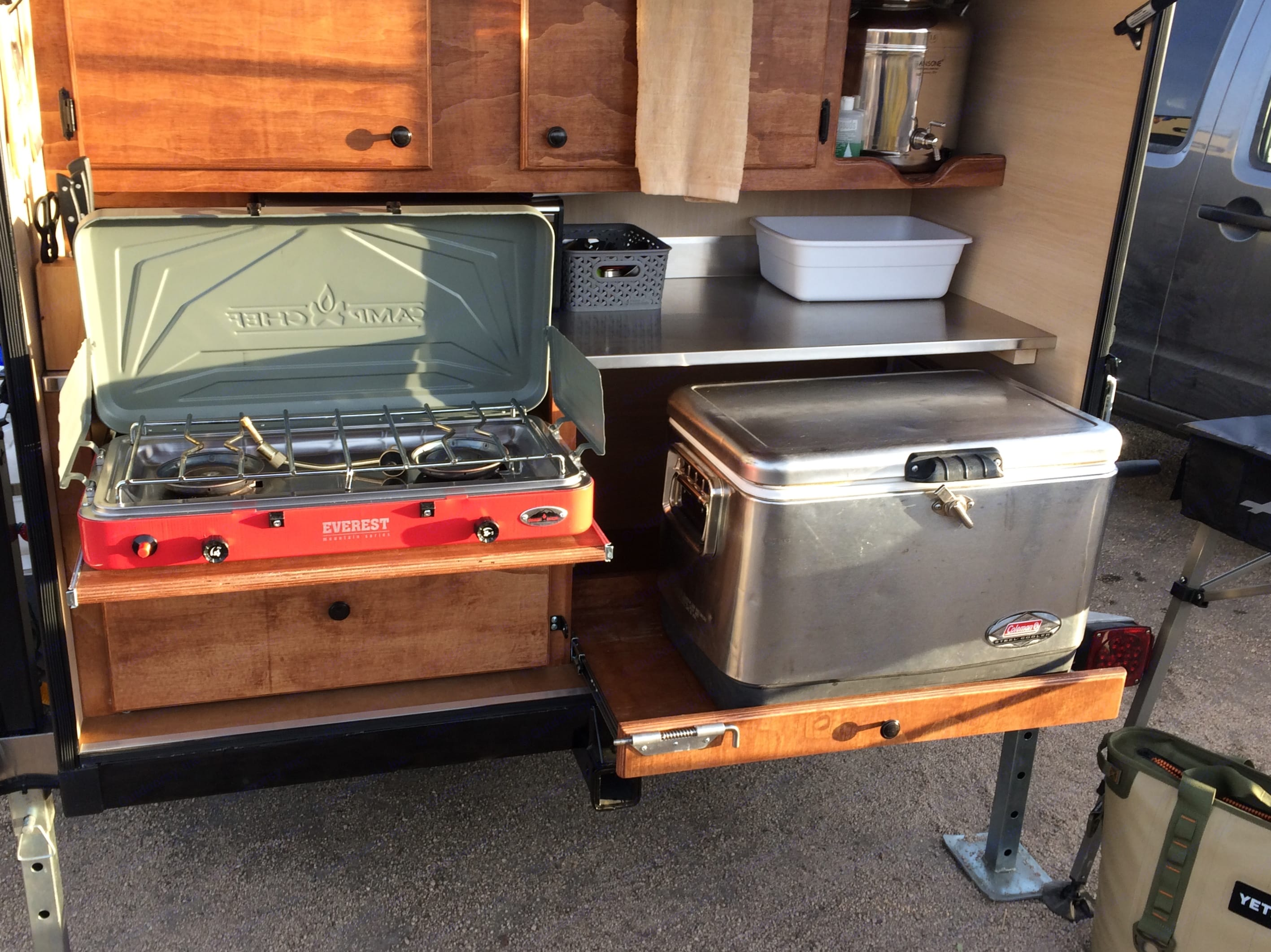 Comes with a Coleman Steel Belted cooler, Camp Chef 2 Burner stovetop with cast iron griddle, Dishwashing tubs, dish soap and towels. .. Alpine Other 2017