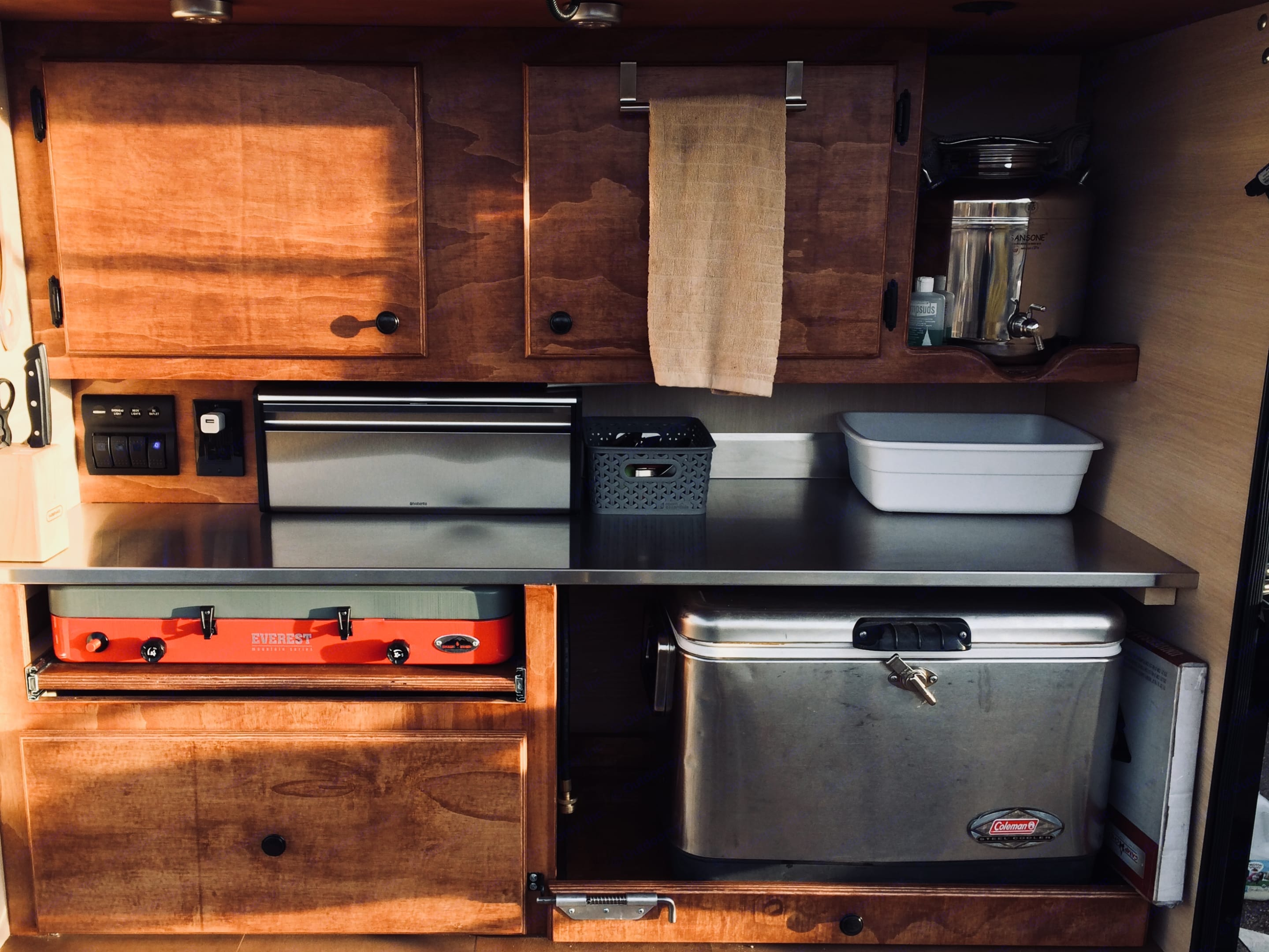 The outdoor camp kitchen is our favorite part of this trailer. Comes loaded with everything you need. All cooking and eating utensils, travel mugs, cups, French press,  kettle, plates, bowls, amazing nesting cook ware, griddle, cutting boards, knife set and a refillable 4 gallon drinking water dispenser, Even dish towels, sponge, salt & pepper, spray oil, spices, aluminum foil, Ziploc bags and trash bags are all included. There is tons of storage for all your food and a bread box. . Alpine Other 2017