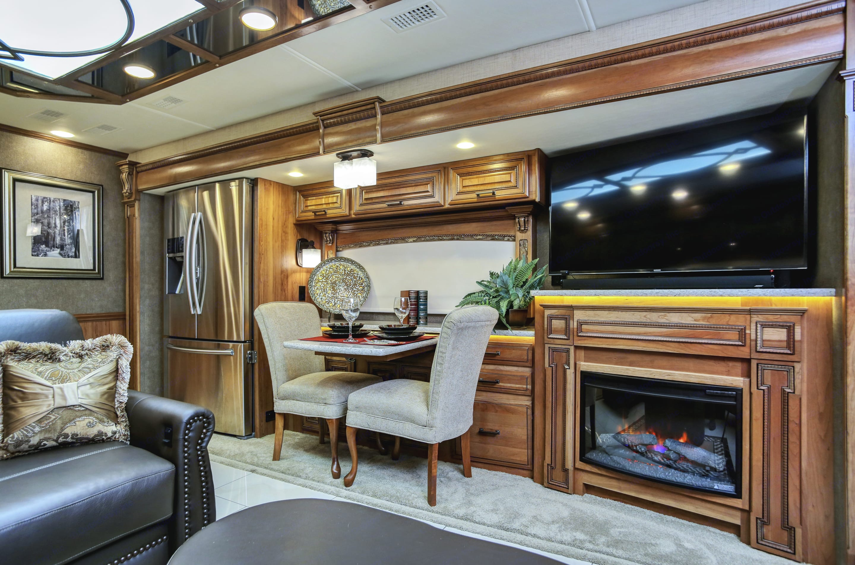 dining for two or four, extra chairs under king masterbed.  Bose sound bar, fireplace with heat. Heated floors, Aqua Hot instant heat, electric or diesel heater for long hot showers and toasty floors. Entegra Coach Cornerstone 2016