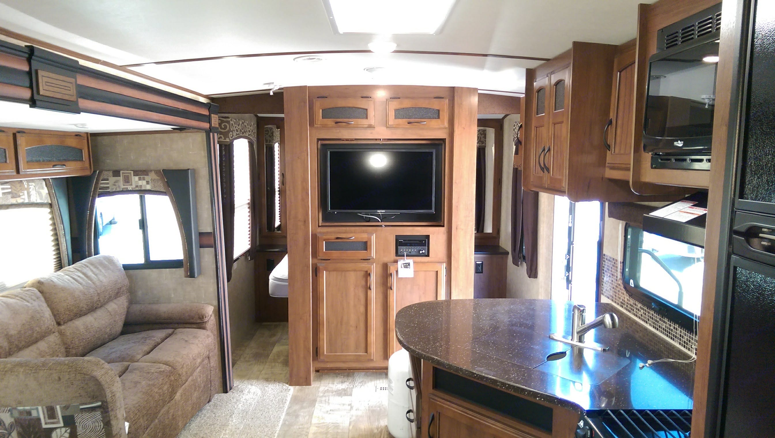 Living area with TV, DVD, with Internal and external speakers.  Slide out allows more room. Jayco White Hawk 2016