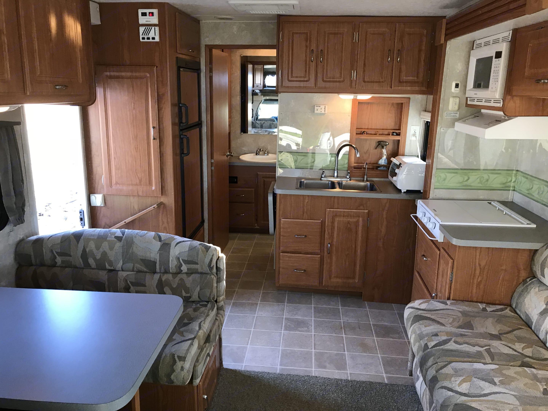 Kitchen, Dining and Living Area, Doorway to bathroom and Master Bedroom. Coachmen Freelander 2004
